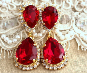 earrings and red image