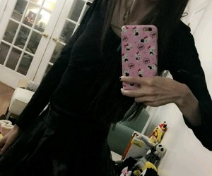 black, thin, and eugenia cooney image