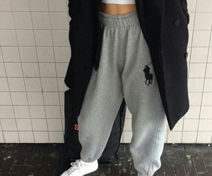 white sneakers, grey sweatpants, and white crop tops image