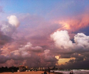 city, clouds, and ocean image