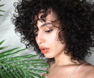 curly hair and val mercado image