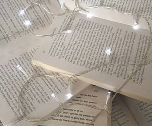 books and fairy lights image