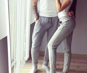 white socks, grey sweatpants, and arm tattoos image