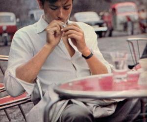 Alain Delon, boy, and cigarette image