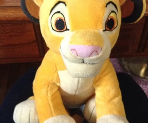 lion king, simba, and stuffed animal image