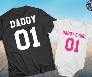 black shirt, pink, and father daughter image