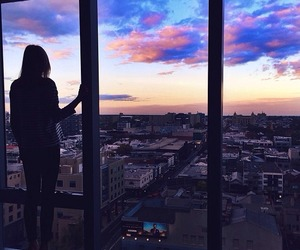 girl, city, and sky image