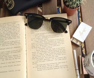 book, sunglasses, and cigarette image
