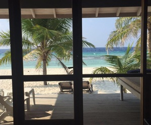 beach, blue ocean, and bungalow image