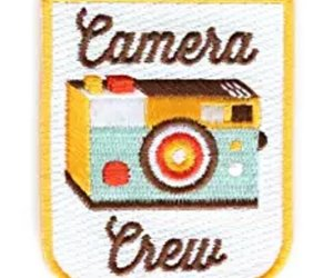 camera, badge, and crew image