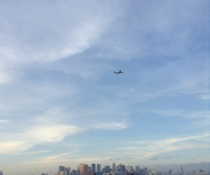 airplane, blue sky, and buildings image