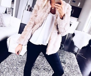 black jeans, faux fur, and white top image