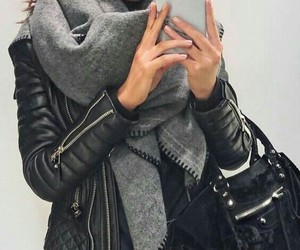 black purse, black ripped jeans, and black leather jacket image