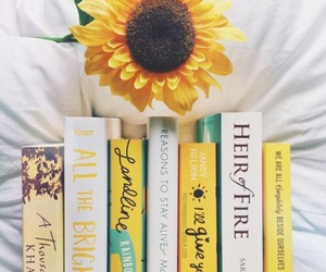 book, yellow, and flowers image