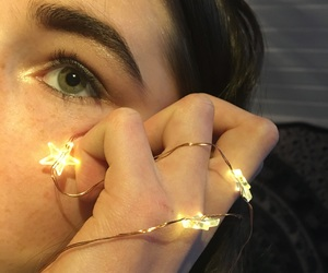 eye, fairy lights, and glitter image