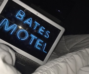 bed, duvet, and laptop image