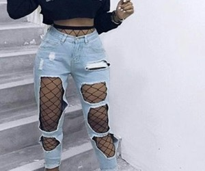 black high heels, light blue ripped jeans, and black fishnet tights image