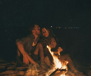 fire, stars, and couple in love image