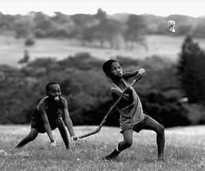 black and white, child, and playing image