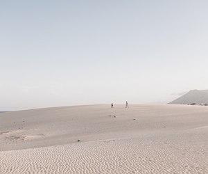 beige, blue, and desert image