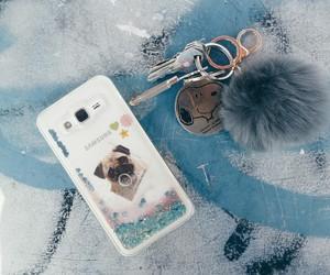 keys, pompoms, and pug image