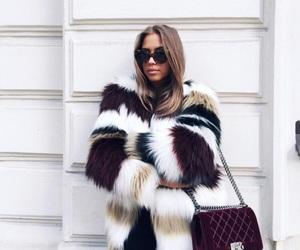 purse, sunglasses, and fur jacket image