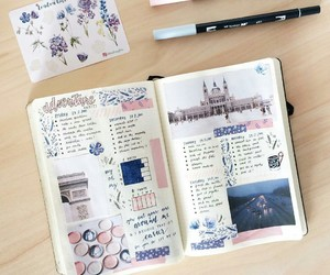 journals, pens, and notebooks image