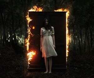girl, fire, and dark image