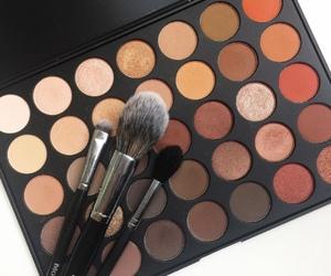 Brushes, eyeshadow, and makeup image