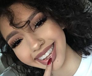 curly hair, makeup, and nose ring image