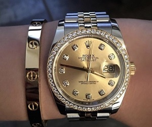 rolex, cartier, and watch image