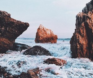 sea, rock, and ocean image