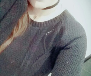 blue lips, necklace, and black pullover image