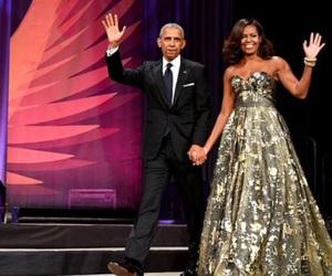 Barak Obama, black suit, and couple image