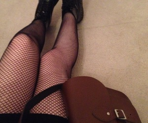 boots, fishnet tights, and fishnets image