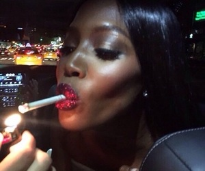 Naomi Campbell, cigarette, and makeup image