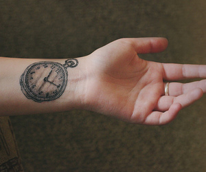 tattoo, hand, and clock image