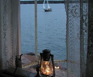sea, light, and boat image