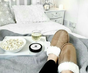 bed, happy, and popcorn image