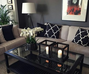 candles, cushion, and decor image
