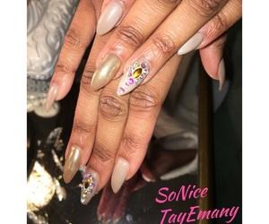 swarovski crystals, nude nail polish, and stiletto nails image