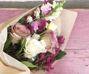 bouquet, cupid, and flowers image