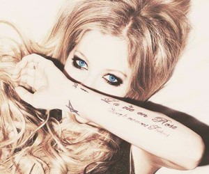 Avril Lavigne and tattoo image
