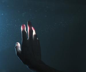 hand, light, and dark image