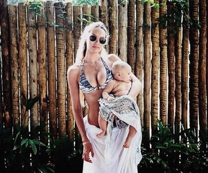 candice swanepoel, baby, and family image