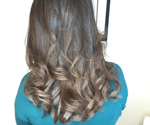 brunette, haircut, and loose curls image