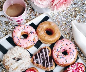 coffee, light pink flowers, and yummy donuts image