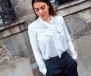 black pants, blouse, and work image