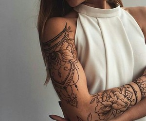 arm tatto and tatto image