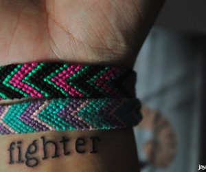 tattoo, fighter, and bracelet image